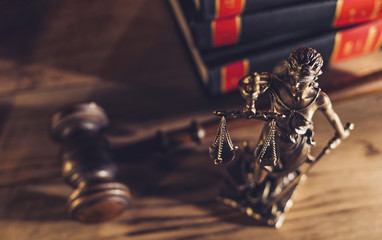 Statue of Justice with gavel in a courtroom. law, advice and justice concept image