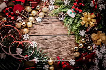 festive background concept with christmas decorating items on wooden background with light filter