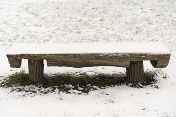 Wooden bench under the snow