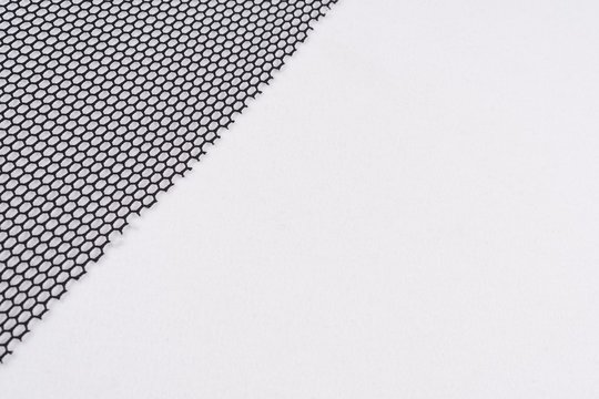 Abstract background black mesh cloth with small cells, texture, background, pattern, copy space.