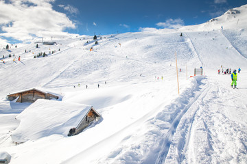 People skiing on prepared slopes covered by fresh snow in Tyrolian Alps, Zillertal, Austria, Europe
