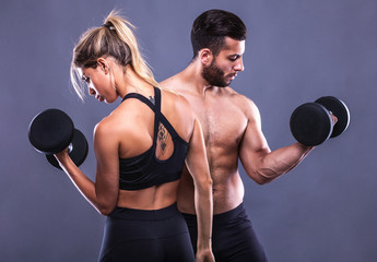 fitness woman and man on a gray background