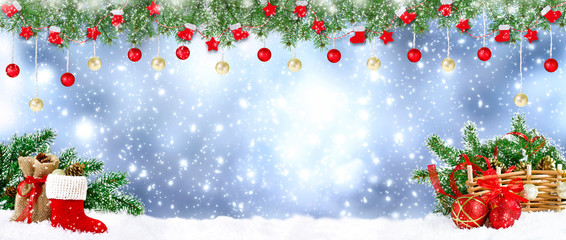 Christmas banner. Santa boot with spruce garland, balls, bag, gifts and cones on snowing background.