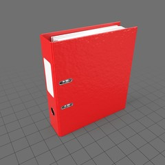 Red plastic binder with label