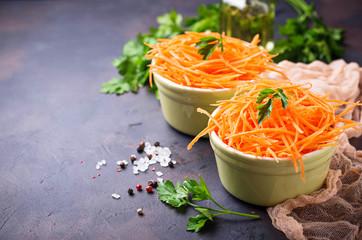 Fresh carrot salad on bowls
