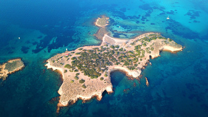 Autumn 2017: Aerial bird's eye view photo taken by drone depicting beautiful deep blue -  turquoise waters and rocky seascape
