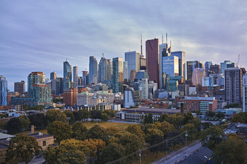 Toronto Skyline in autumn - Facades and rooftops of skyscrapers in the  Financial District of Toronto at sunset