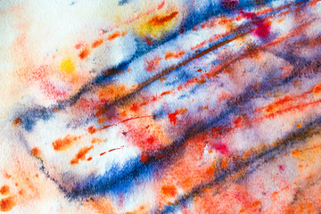 Colorful (blue, green, yellow, orange, red) background of watercolor painting on the paper