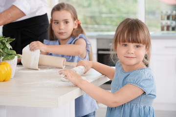 Cute children in kitchen during cooking classes