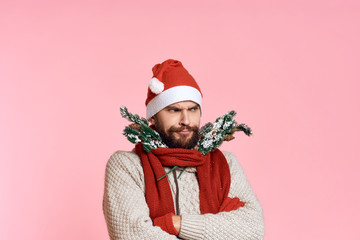 light pink background, free space for copy, artificial tree branches, scarf, man, new year