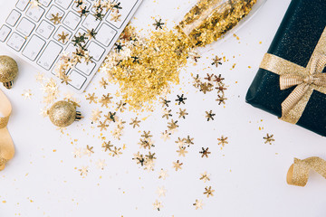 Keyboard and Champagne glasses with golden confetti. Office Desk. Working Happy New Year