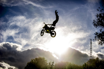 Motorcyclist jumping with motorcycle..