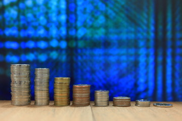Coin tower stacked in decline chart digital bokeh light in the background