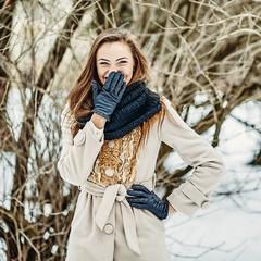 Happy girl having fun in winter park