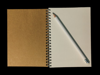 Clear color note book opened for note or lecture note or memo for remine and brown cover whit black head color pencil in white apparel in black background.