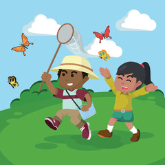 African boy and african girl catching butterflies