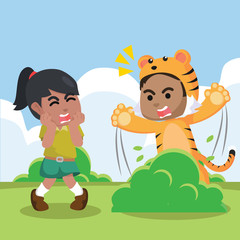 A boy wearing a tiger costume for surprising a girl