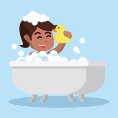 Girl in bathtub holding a toy duck