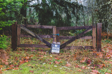 No Trespassing Sign on Wood Gate