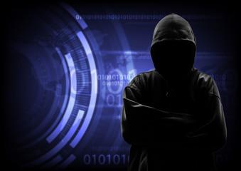 Hooded computer hacker stealing information