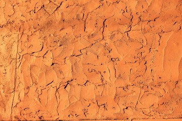 Rough orange stucco wall horizontal background