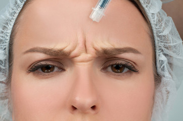 Woman is getting botox injection. Anti-aging treatment and face lift. Cosmetic Treatment and Plastic Surgery