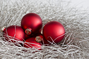 Red Christmas Ornaments in a Silver Glitter Wreath