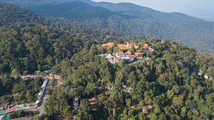Aerial view of Wat Phra That Doi Suthep on the mountain. The attractive sightseeing place for tourists and landmark of Chiang Mai, Thailand.