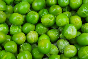 Frozen pea peases texture background. Green pease background pattern. Vegetable.