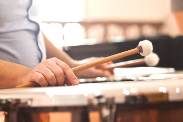 Hands musician playing the timpani closeup