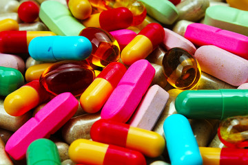 Medical or vitamin pills. Colorful medicine pills as texture. Pill pattern background. Green,red pink blue yellow.
