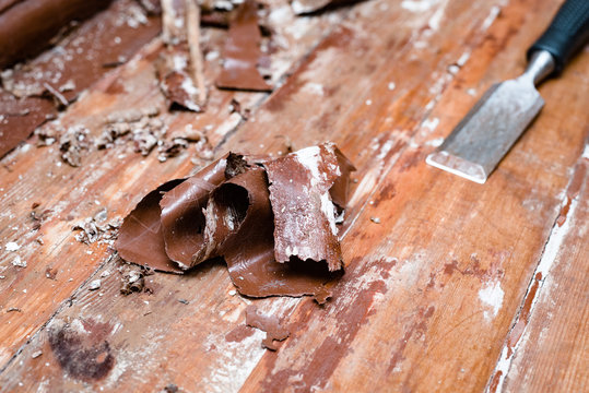 removing paint from the floor with a hot air gun repair tools chisel debris background texture wallpaper