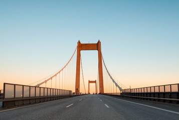 A bridge between Denmark and Sweden early in an autumn morning. A Danish-Swedish detective series of the same name is connected with this bridge. The picture is taken in direction of Denmark.