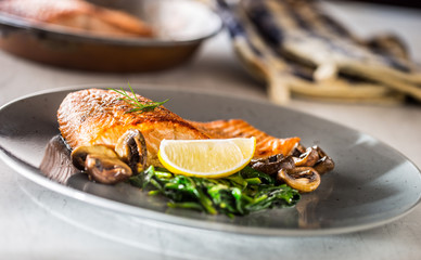 Salmon Roast Fillet. Portion of roast salmon fillet with spinach mushrooms in restaurant pub home or hotel