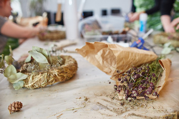 Workshop Master class handmade in making Christmas wreaths and rustic style. Christmas wreaths made of straw and various herbs. Christmas decor made by your own hands