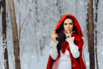 Snow Princess in Red Cape Keeping a Secret in Winter Fairy Tale
