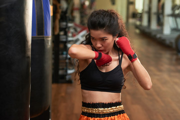 Exercising with punching bag