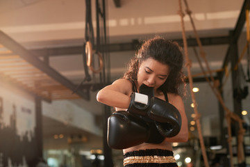 Wearing boxing gloves
