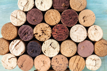 Closeup of corks laid out in the form of Christmas tree