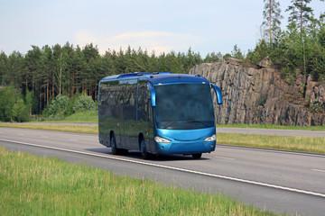 Blue Coach Bus on Summer Freeway