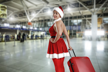 Woman with red big suitcase on airport