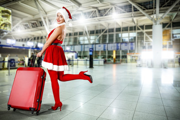 woman in red dress and sexy heels with suitcase