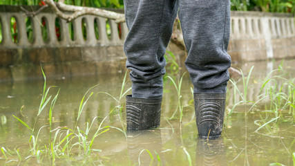 Men wear black boots for a flood.