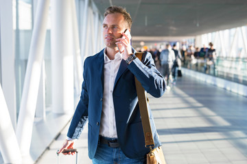 Man talking on phone in airport