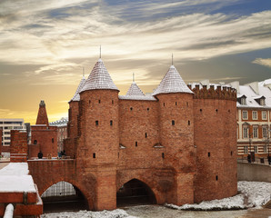 Warsaw Barbican, a medieval fortification in Warsaw at sunset, Poland