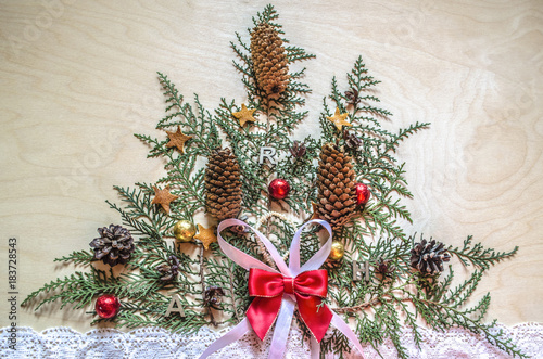 Light Plywood With A Christmas Tree Made Of Twigs Thuja Fir Cones And Chocolate