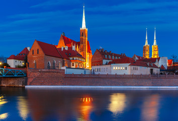 Cathedral Island or Ostrow Tumski with Cathedral of St. John and church of the Holy Cross and St. Bartholomew at night in Wroclaw, Poland