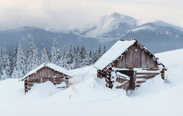 Cabin in the mountains in winter. Mysterious fog. In anticipation of holidays. Carpathians. Ukraine, Europe. Happy New Year
