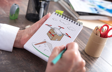 Drone delivery concept on a notepad