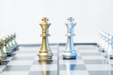 A conceptual photo with chess pieces on a chessboard. Business, law or political concept, which could represent war of corporations, geopolitical situation and so on. Selective focus.